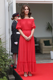 Kate Middleton was a boho beauty in a red off-the-shoulder maxi dress by Alexander McQueen at the Queen's birthday party in Berlin.