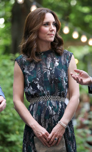 Kate Middleton finished off her look with a triple-strand pearl bracelet.
