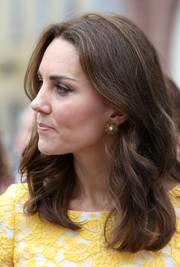 Kate Middleton accessorized with a lovely pair of pearl starburst studs by Oscar de la Renta while touring Heidelberg, Germany.