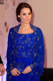Kate Middleton attended a charity gala in India sporting a matching beaded clutch and gown ensemble.