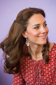 Kate Middleton complemented her pretty hairstyle with dangling bead earrings by Accessorize.