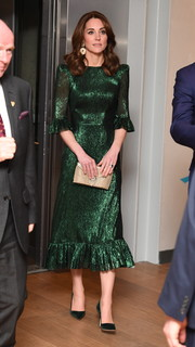Kate Middleton was shining in a green midi dress with a ruffled hem and sleeves while attending a reception in Dublin, Ireland.