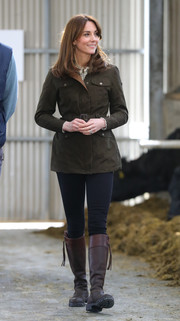 Kate Middleton geared up for the outdoors in a brown utility jacket by Dubarry while visiting the Teagasc Animal & Grassland Research Centre in Ireland.