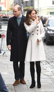 Kate Middleton showed off her cute winter style with this double-breasted white coat by Reiss while touring Dublin, Ireland.