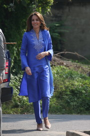 Kate Middleton visited a school in Islamabad, Pakistan wearing a traditional blue 'shalwar kameez' by Maheen Khan.