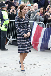Kate Middleton toured Manchester wearing a plaid coat by Erdem.