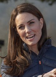 Kate Middleton sported her usual side-parted style with wavy ends while visiting the Roscor Youth Village in Northern Ireland.