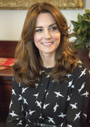 Kate Middleton wore her hair in bouncy curls while receiving visitors at Kensington Palace.