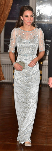 Kate Middleton looked breathtaking in a floral-sequined ice-blue gown by Jenny Packham while attending a dinner at the British Embassy in Paris.