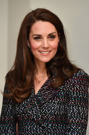 Kate Middleton wore her hair down with curly ends on day 2 of her Paris trip.