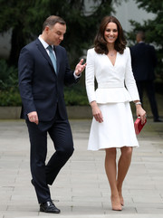 Kate Middleton kept it simple yet smart in a white peplum coat dress by Alexander McQueen on day 1 of her official visit to Poland.