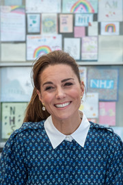 Kate Middleton wore her hair in a casual ponytail while visiting Queen Elizabeth Hospital.