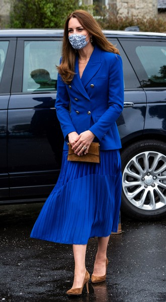 Kate Middleton matched her blazer with a pleated midi skirt from Hope Fashion.