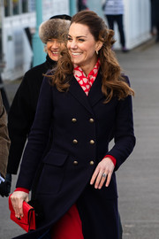 Kate Middleton accessorized with a chic red croc envelope clutch by Mulberry while visiting Wales.