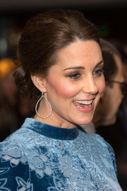 Kate Middleton perfected her look with a pair of dangling diamond earrings by Robinson Pelham.