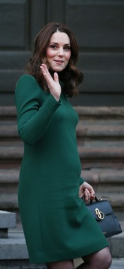 Kate Middleton opted for a simple long-sleeve green dress by Catherine Walker when she visited the Nobel Museum during her visit to Sweden.