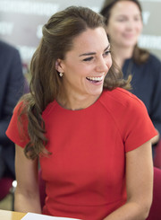 Kate Middleton looked lovely, as always, wearing this half-up style with curly ends while visiting the YoungMinds Mental Health charity helpline.