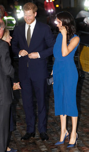 Meghan Markle matched her dress with a pair of blue slingback pumps by Aquazzura.
