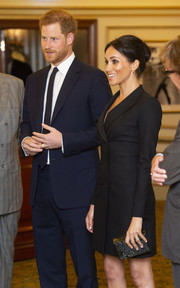 Meghan Markle paired a speckled box clutch by Stella McCartney with a black tux dress for a gala performance of 'Hamilton.'