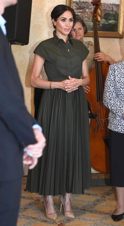 Meghan Markle opted for a dark green shirtdress by Brandon Maxwell when she attended a reception during her official visit to Australia.