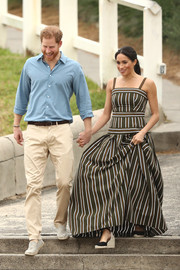 Meghan Markle looked summery in a striped maxi dress by Martin Grant while visiting Bondi Beach in Australia.