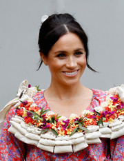 Meghan Markle looked retro-chic with her beehive while visiting the University of the South Pacific in Fiji.