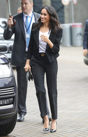 Meghan Markle looked smart in a black Givenchy pantsuit while visiting Croke Park during her tour of Ireland.