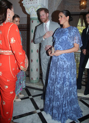 Meghan Markle chose a periwinkle print gown by Carolina Herrera for an audience with King Mohammed VI of Morocco.