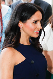 Meghan Markle glammed up with a pair of white topaz hoops by Emily Mortimer.