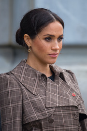 Meghan Markle styled her hair into a center-parted bun for her visit to the UK war memorial in Wellington, New Zealand.