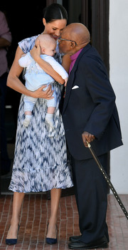Meghan Markle looked summer-chic in a printed midi dress by Club Monaco while meeting with Archbishop Desmond Tutu.