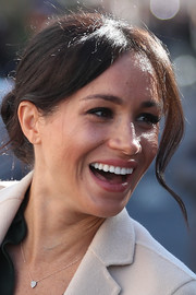 Meghan Markle styled her hair into a loose bun for her visit to Sussex.