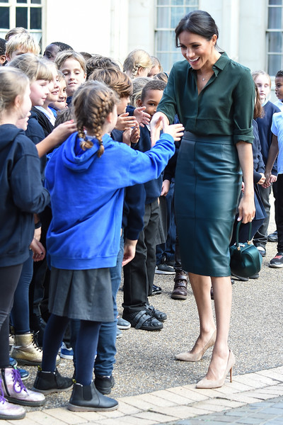 Meghan Markle completed her monochromatic look with a green leather purse by Gabriela Hearst.