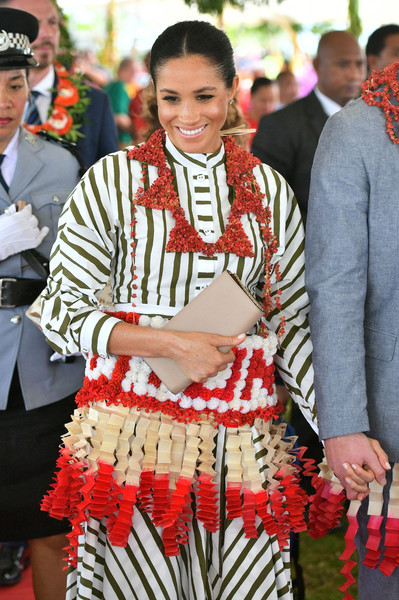 Meghan Markle accessorized with a simple nude leather clutch by Prada while attending an exhibition of Tongan handicrafts.