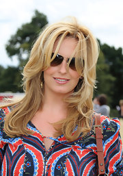 Penny Lancaster wore her hair down in a sot layered cut.