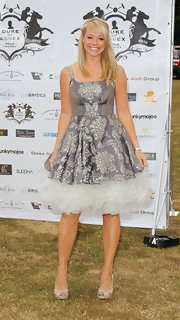 Liz Mcclarnon's gray brocade dress featuring a voluminous white petticoat was a peachy little number.
