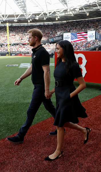 Meghan Markle teamed pointy flats by Aquazzura with a little black dress for the Boston Red Sox vs. New York Yankees game.