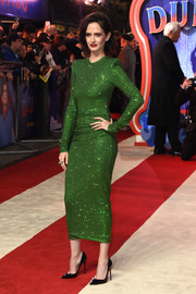Eva Green teamed her chic dress with black patent pumps by Christian Louboutin.