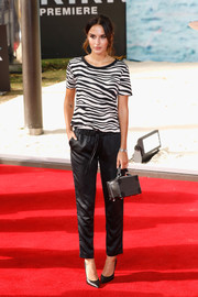 Lucy Watson teamed her tee with black satin pants.