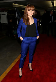 Olivia Cooke looked cool and classy in a bright blue pantsuit paired with a black blouse.