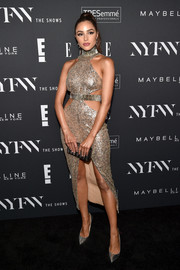 Olivia Culpo coordinated her dress with an embellished box clutch.