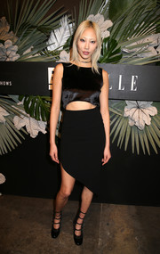 Soo Joo Park looked sassy in a dual-textured LBD with a midriff cutout and an asymmetrical hem at the E!, ELLE and IMG celebration to kick off NYFW.