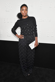 Gabrielle Union coordinated her outfit with a white star-print clutch.