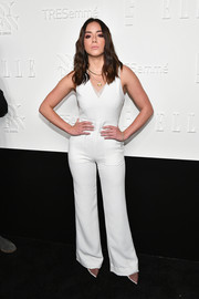 Chloe Bennet kept it minimal in a sleeveless V-neck white jumpsuit by Wai Ming at the NYFW kickoff party.