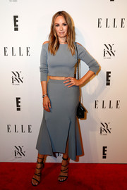 Catt Sadler was trendy in a gray cold-shoulder crop-top and a matching slashed-hem skirt while attending the E! + Elle + IMG party.