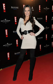 Kate Hall was sexy on the red carpet in a fitted white mini dress paired with black suede over-the-knee boots.