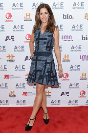 Ana Ortiz chose a blue patchwork-style dress for her red carpet look at the A&E Upfront event in NYC.