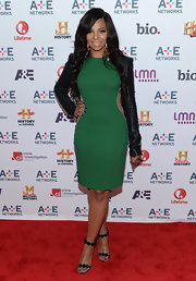 Ashanti added a touch of rock 'n' roll style to her red carpet look with this structured black leather jacket.