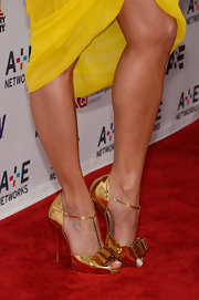 Roselyn Sanchez brought out the hardware on the red carpet when she rocked this pair of metallic gold pumps that featured a bow detail on the toes.