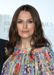 Keira Knightley sported her trademark boho waves at the EE British Academy Awards nominees party.